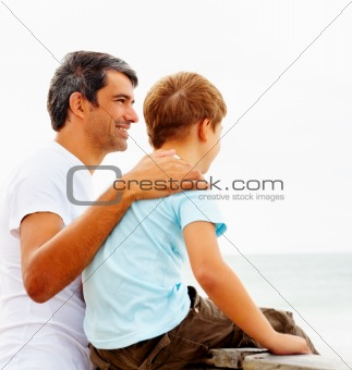 Father and son enjoying the serene beach view