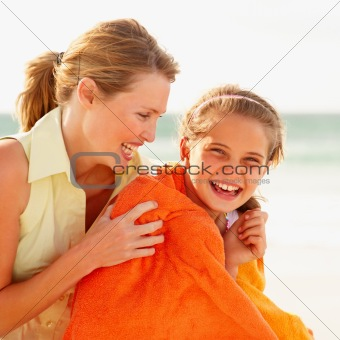 Happy mother and daughter while on a beach vacation