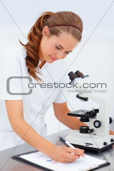Successful young female researcher working in the laboratory, ma