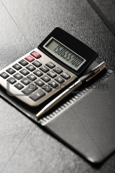 Calculator with a pen