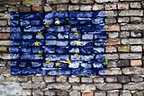 Flag of the European Union painted on an old brick wall