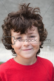 Beautiful little boy with red shirt