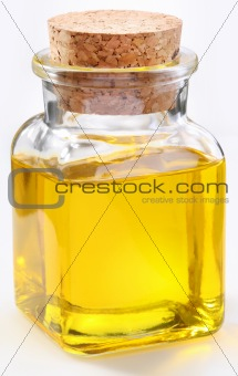Bottle of olive oil on a white background