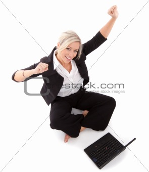 beautiful businesswoman punches the air