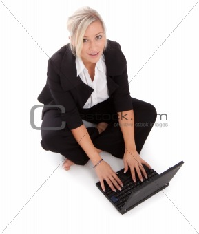 beautiful businesswoman uses her netbook wirelessly