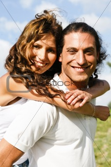 Attractive man carrying woman