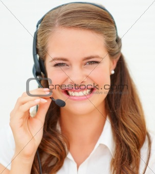 Closeup of a pretty young woman with a headset, isolated