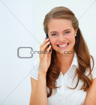 Cute young woman having a conversation over the cellphone, over