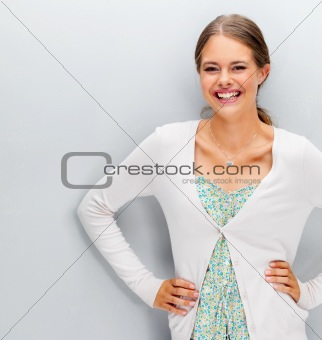 Portrait of a pretty woman posing on grey background