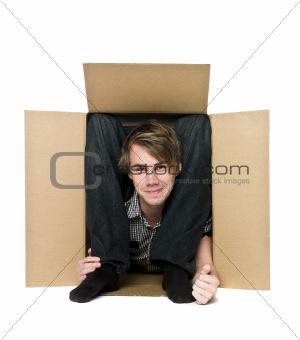 Acrobat inside of a cardboard box.