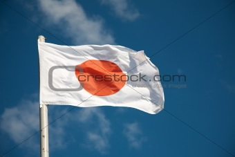 Japanese flag against blue sky