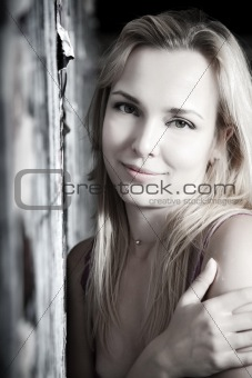 Smiling Woman Against Urban Wall