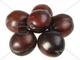 Group of dark-purple plums.