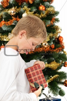 Boy opening christmas present