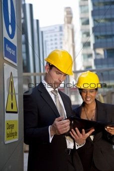 Male and Female Construction Site Managers Having A Meeting