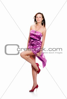 Beautiful young female wearing lilac dress, dancing, isolated on white