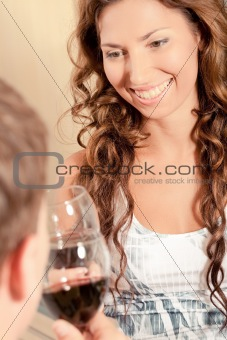 Couple drinking wine and smiling