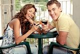Love couple taosting red wine