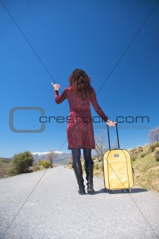 back woman hitch-hiking