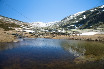 dark lake at gredos mountains