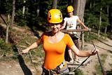 woman wearing professional climbing gear with helmet pulley and carabiner