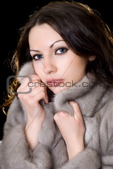 Young beautiful woman in a fur coat