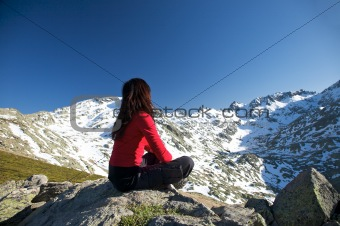 sitting with snow mountains