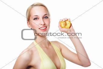 Beautiful healthy woman squeezes out juice of a peach