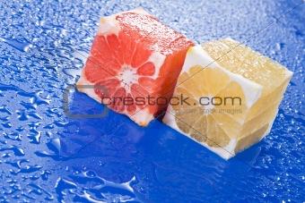 Citrus cubes on blue surface