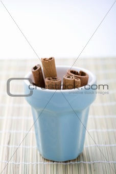 Cinnamon sticks in a cup.