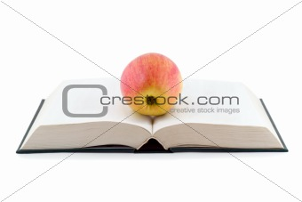 apple on opened book