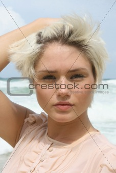 Blond woman at the beach.