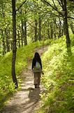 woman hiking at charming forest