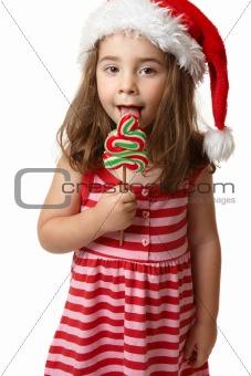 Santa girl licking Christmas tree lollipop candy