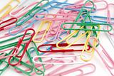 Colored paper clips on white