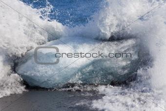 Waves Breaking Against an Iceberg On Black Sand Beach, Iceland