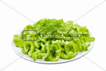 Green pepper on white plate