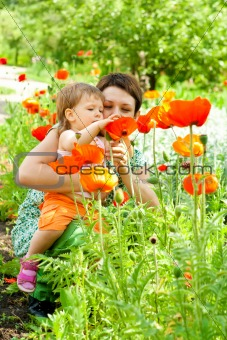 Mother showing flowers to daughter