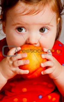 Baby eating peach
