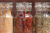 Glass Bottles of Various Cooking Spices