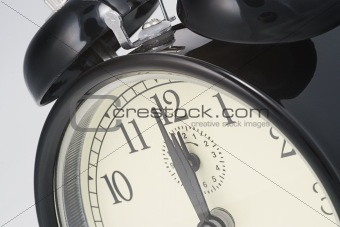 alarm clock set to  twelve o`clock