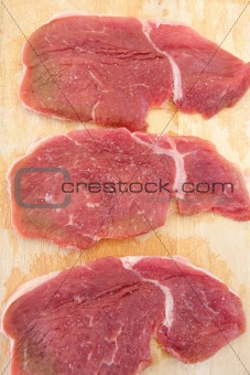 Three steaks raw salted pork