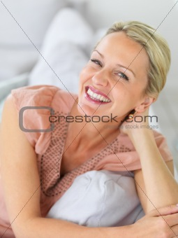 Pretty woman smiling at home