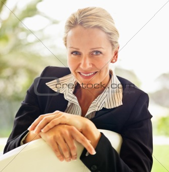 Mature business woman smiling confidently
