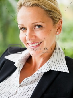 Closeup of a mature business woman smiling confidently
