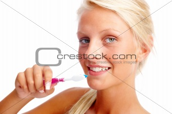 Closeup of a beautiful girl with toothbrush isolated