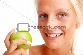Happy young female holding a green apple, isolated