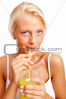 An attractive lady sipping juice with a straw