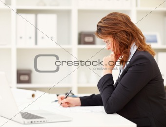 Business woman busy at work , making documents