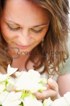Close up of a young woman with flowers, isolated